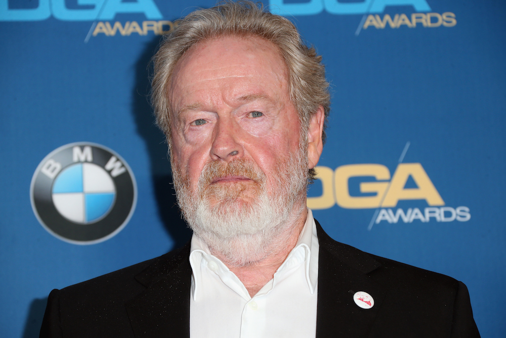 Ridley Scott stares ahead while walking the carpet at an event