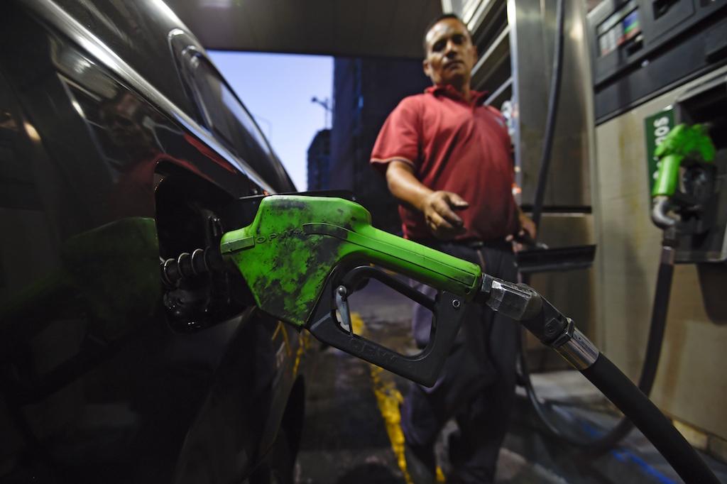 A man fills his gas tank