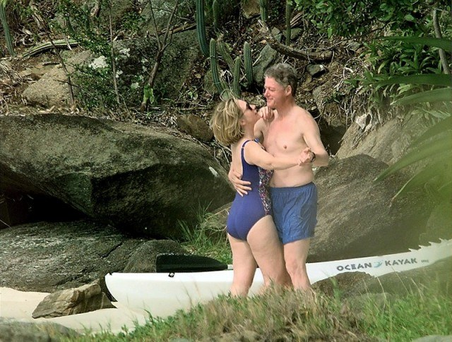 Bill and Hillary Clinton outdoors in swimwear