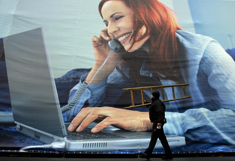 Worker strolls past work from home billboard