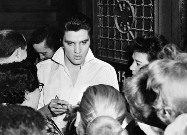 Elvis Presley greeting fans.