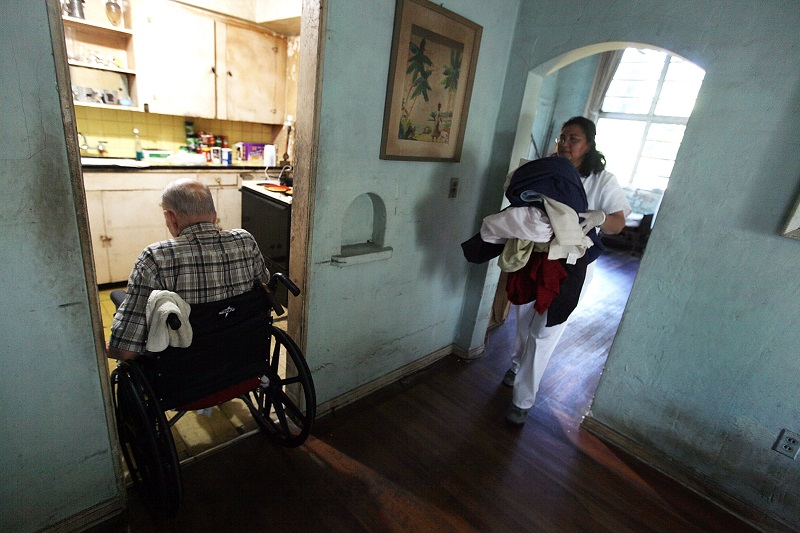 In-home care giver   Joe Raedle/Getty Images