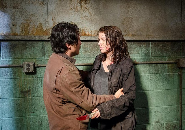 Glenn (Steven Yeun) embraces Maggie (Lauren Cohan) in a scene from Season 6 of AMC's 'The Walking Dead'