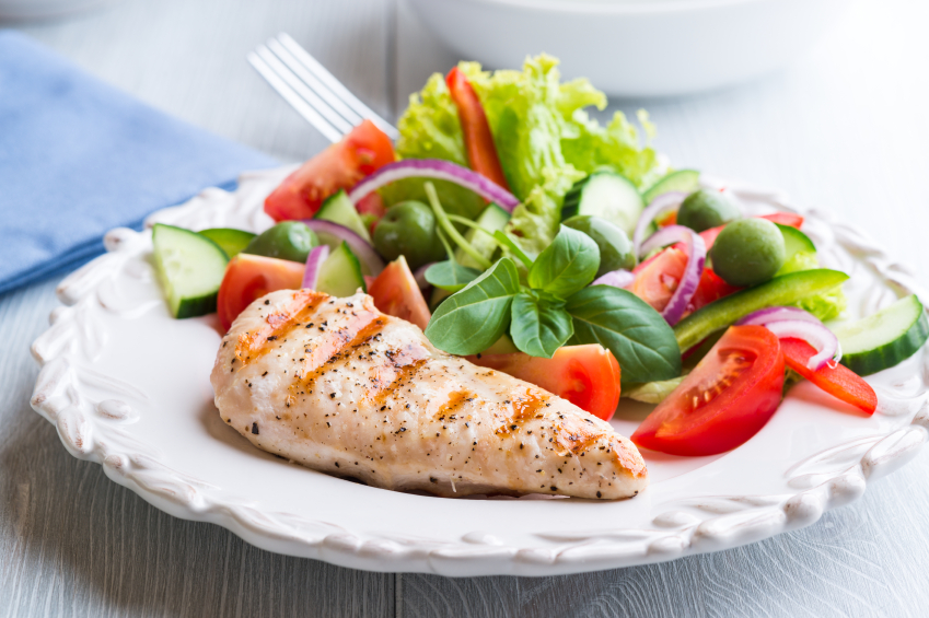 Grilled chickenbreast and salad on a white plate
