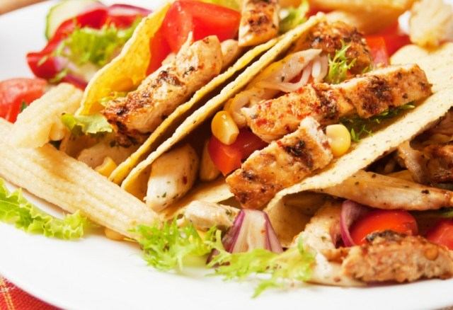close up of grilled chicken and salad