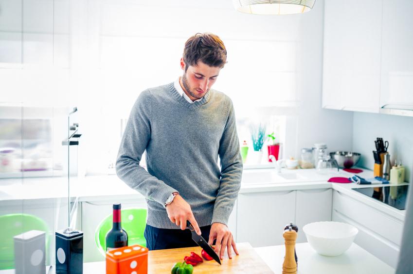 A man cutting vegetables