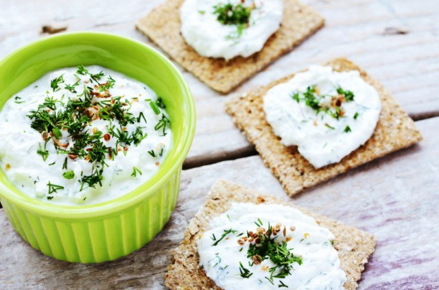 ramekin filled with a homemade cottage cheese and herb spread