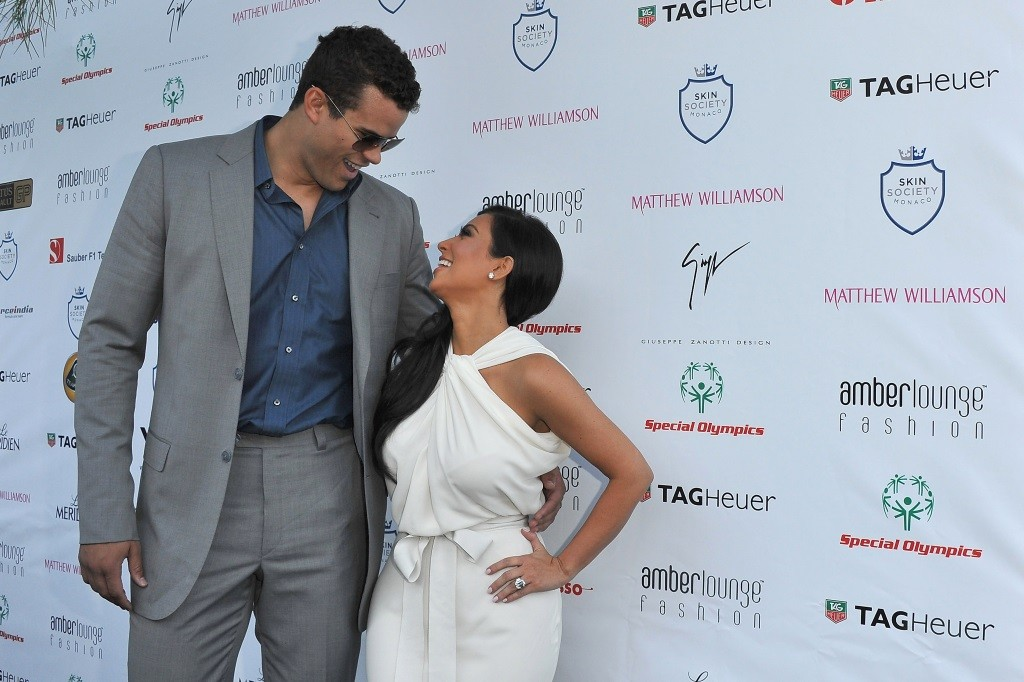 Kris Humphries and Kim Kardashian smile and look at each other while on the red carpet