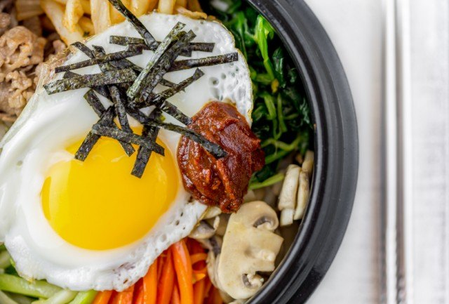 close up of a Korean dish with fried egg on the top