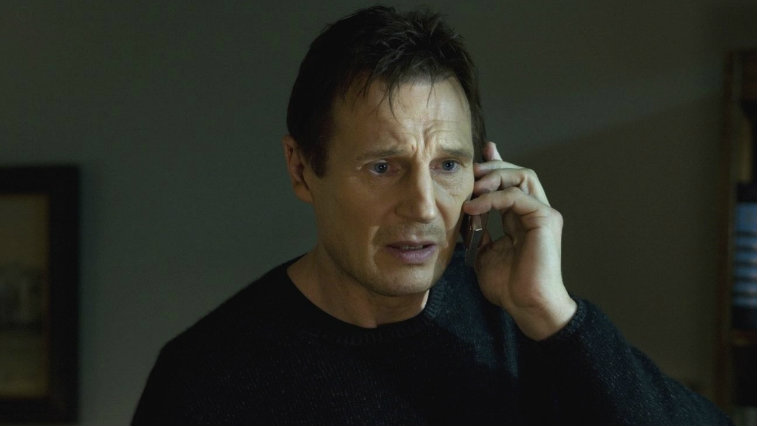 Liam Neeson on the phone