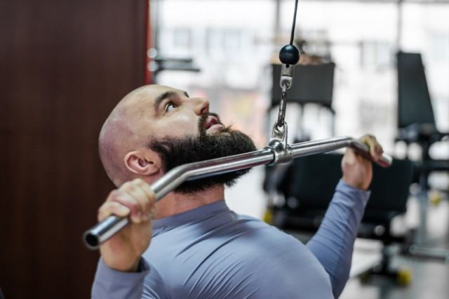 A man doing a shoulder and chest workout at a gym