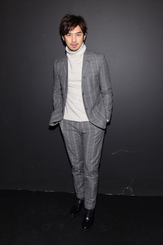 stylish man wearing sweater and suit