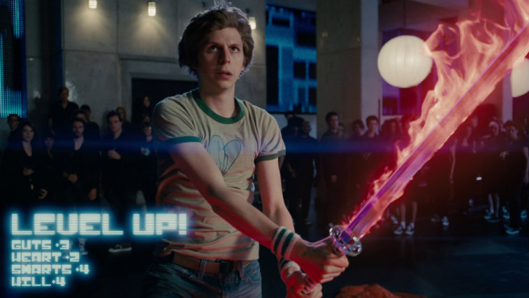 Michael Cera holds a flaming red sword in Scott Pilgrim vs. the World