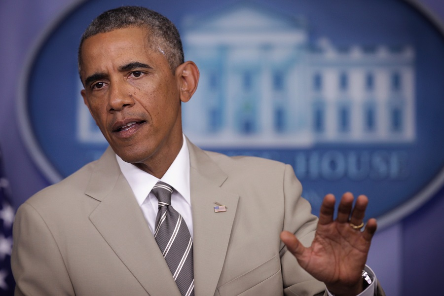 Obama wearing a tan suit
