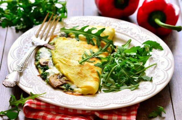 Omelet stuffed with herbs and mushrooms.