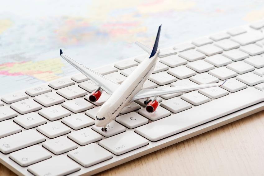 airplane model on white computer keyboard