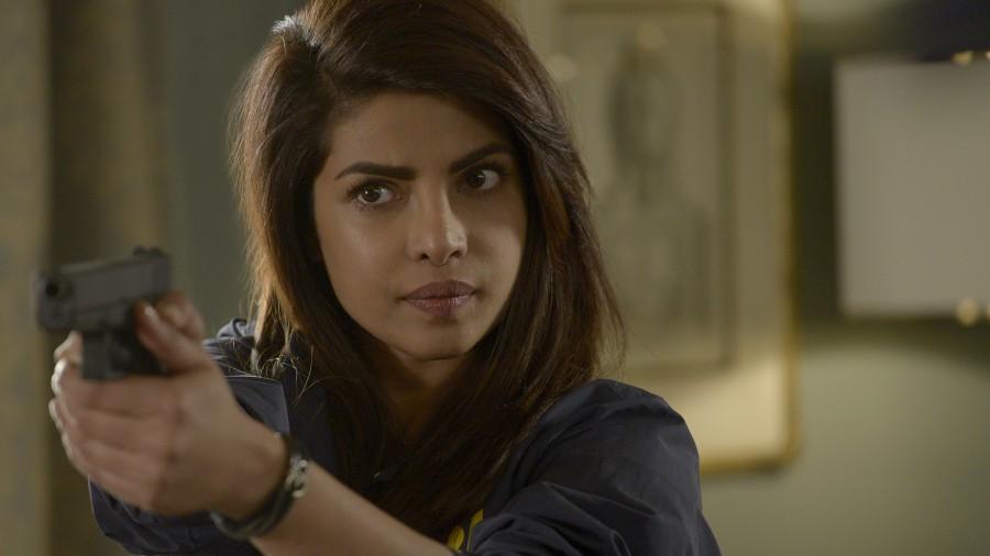 Priyanka Chopra's Alex Parrish holds up a gun in a scene from ABC's Quantico