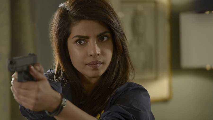 Priyanka Chopra holds up a gun in the show Quantico