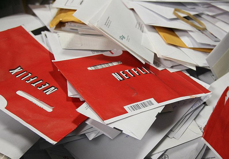 Netflix envelopes hold DVDs in a bin of mail