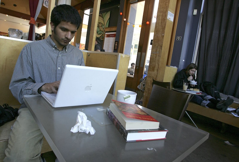 A cafe customer uses free WiFi access in San Francisco