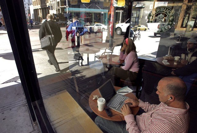 People use free WiFi at a Starbucks in San Francisco