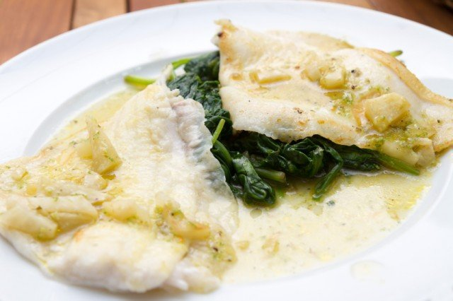 flounder fillets on wilted spinach