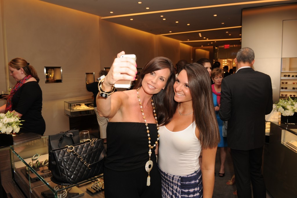Shoppers take a selfie at the mall