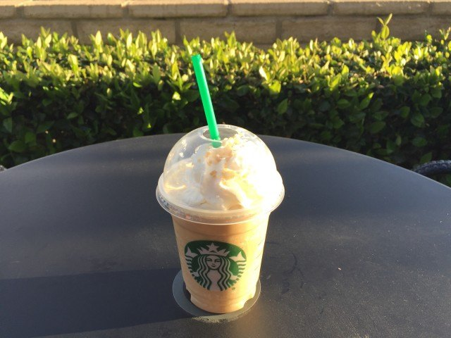 Starbucks Caramelized Honey Frappuccino on patio table