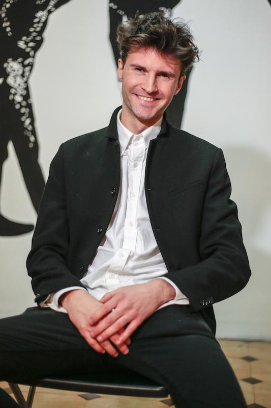 A stylish man wearing a white shirt