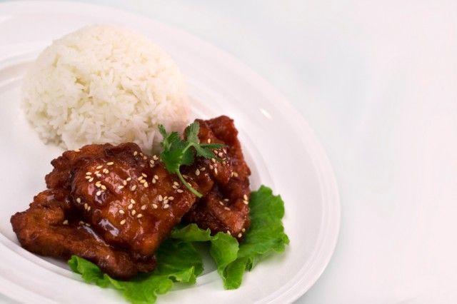 Pork Chops With Teriyaki Sauce And Sesame Seeds With Rice