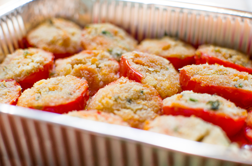 close up of tomatoes gratin in a baking dish