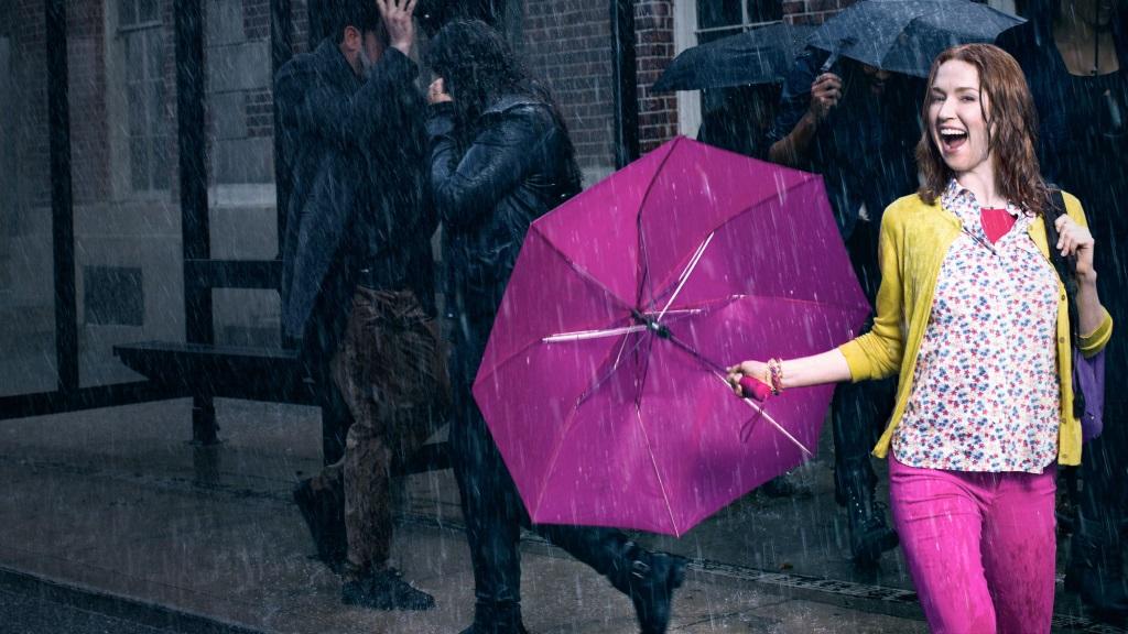 Kimmy is holding a purple umbrella.