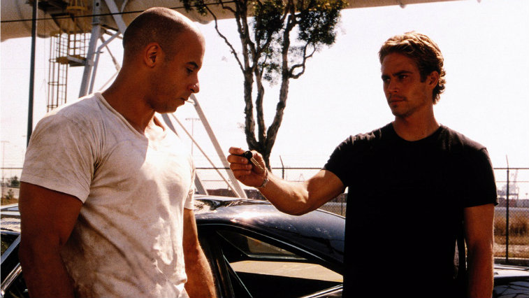 Paul Walker hands keys to Vin Diesel in The Fast and the Furious
