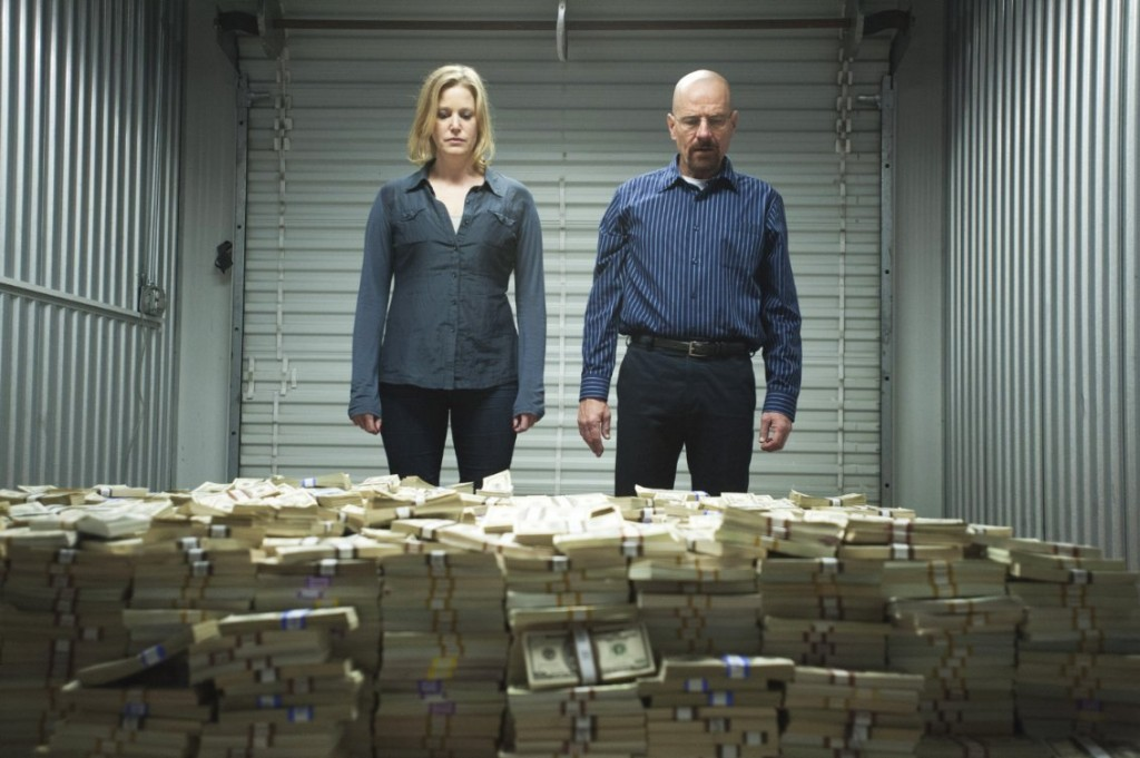Breaking Bad's Walter and Skyler White stare at their earnings