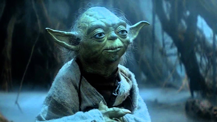 Yoda looking up, with his hands folded