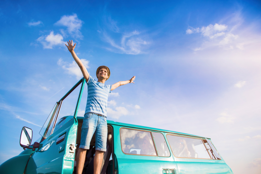 Man happy to be outside in front of van