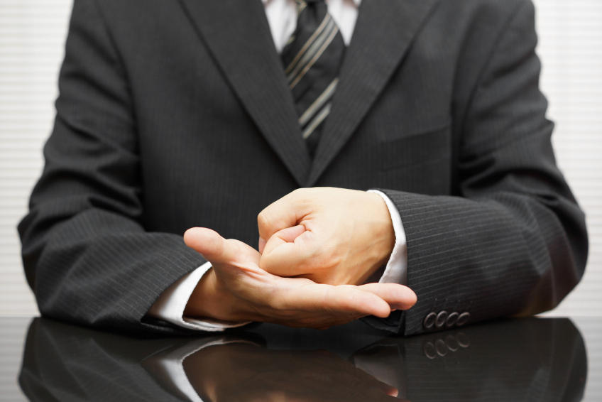 businessman making a fist
