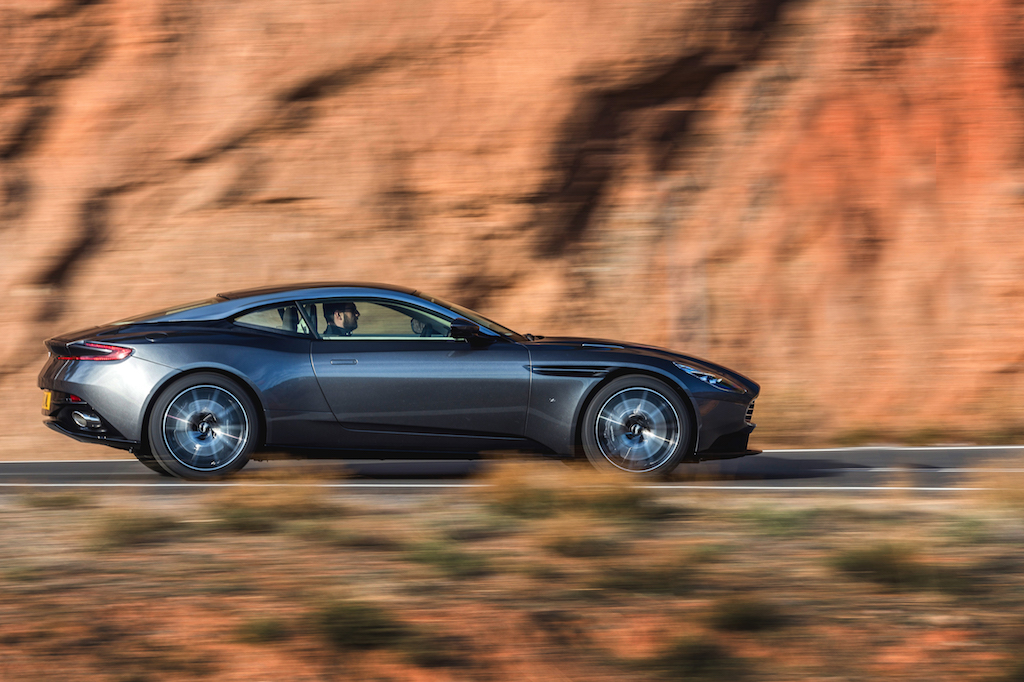 Aston Martin DB11 speeding down the road.