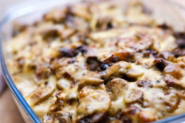 baked casserole with potatoes, cheese, and mushrooms
