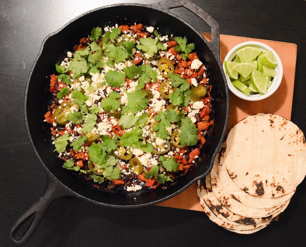 chorizo-black bean filling in a cast-iron skillet to make tacos