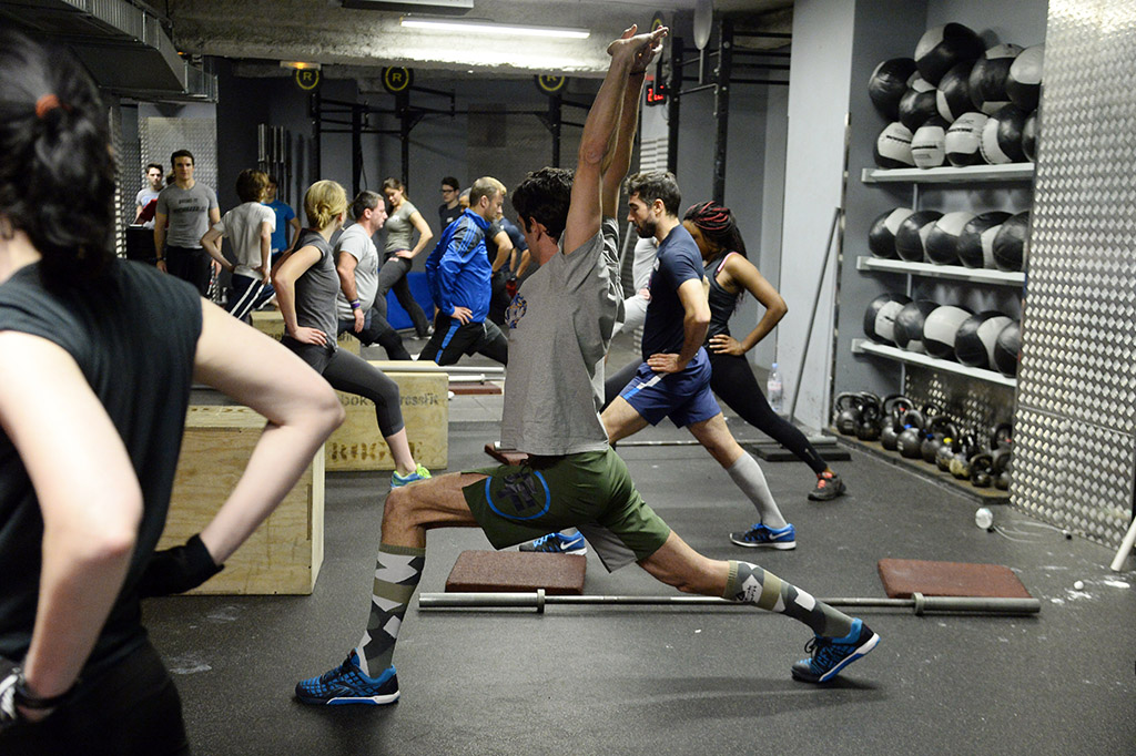 group of athletes doing lunges at a CrossFit facility in France