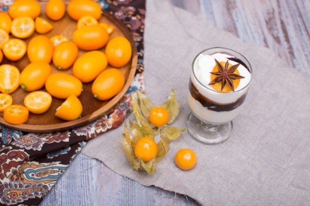 custard parfait with kumquats and spices in a glass