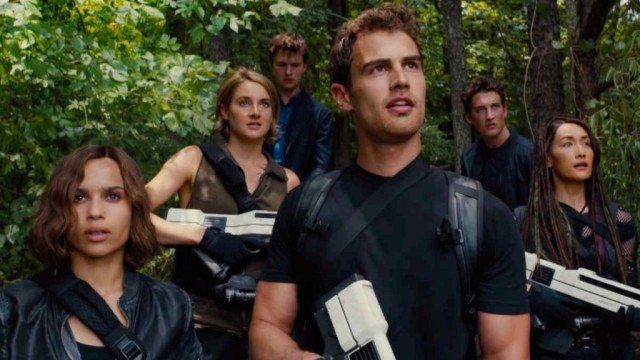 The rebels of 'Divergent: Allegiant' gather in the woods.