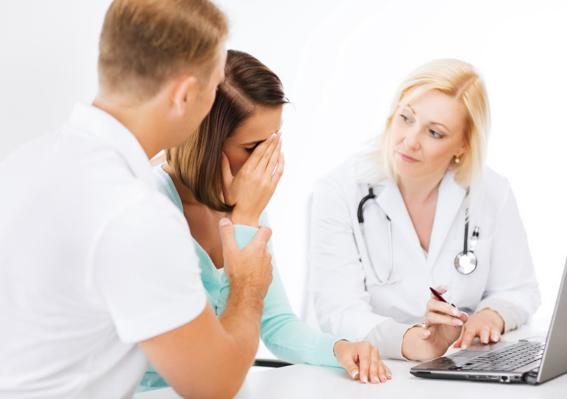 couple meeting with a female doctor