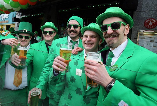 Group of men toast beers for St. Patrick's Day in Dublin, Ireland