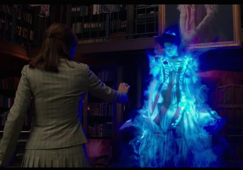 Kristen Wiig is looking at a ghost in Ghostbusters.
