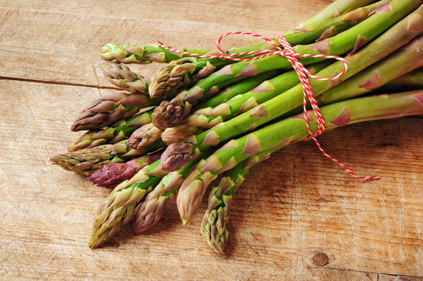 green asparagus on a wooden background