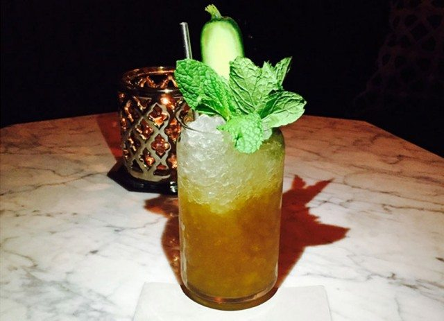 Guillotine cocktail with fresh cucumber and mint from Ivo Diaz at Garfunkel's Speakeasy