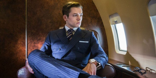 Eggsy (Taron Egerton) sits on a plane in a scene from 'Kingsman: The Secret Service'