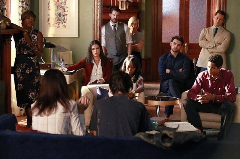 The cast of How to Get Away with Murder sits around a living room